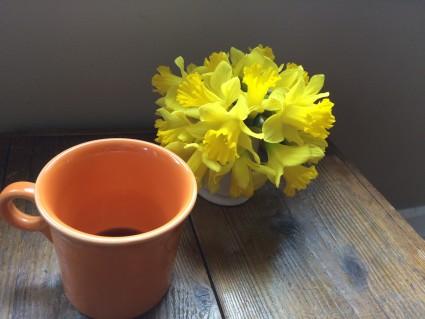 yellow daffodils from Beza and an orange mug to remember Kalkidan