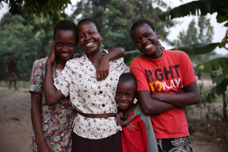 Betty - 5 children (these 3 are Goretti (far right), Emmanuel and Josephine
